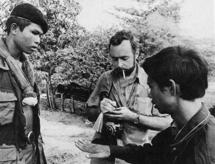 "Sydney H. Schanberg (center), the Pulitzer Prize-winning war correspondent for The New York Times, has died at 82, having exposed ""The Killing Fields"" of Cambodia in the 1970s with his translator and friend Dith Pran (right). The United States bombed Cambodia in 1973 as part of a Vietnam-related intervention into Cambodia's civil war; U.S. technology and military might could not prevent the Khmer Rouge from toppling the government, setting off a genocide so deadly as to rank near the Holocaust in its brutality. Told to get out by their superiors in New York, Schanberg and Dith remained at work and were seized by Pol Pot's teenage soldiers. They ended up at the French Embassy, though Dith was later expelled with other Cambodians as the French themselves became targets; Schanberg and other foreigners were evacuated to Thailand, where he reported on the fall of Phnom Penh and the complete expulsion of the city of two million. He made his way back to the USA and helped Dith's wife and children establish a new life in San Francisco. After many sufferings, Dith was able to escape to Thailand and reunited with his family and mentor. Schanberg wrote a Times magazine story, ""The Death and Life of Dith Pran,"" which was later released as a book, then made into a film starring Sam Waterston and Dr. Haing S. Ngor, a physician and genocide survivor who won an Academy Award for his portrayal of Dith, who died in 2008. Schanberg won many awards in his career, but always insisted he was only a co-winner of the Pulitzer with Dith Pran; they stayed friends the rest of their lives. (via The New York Times)"