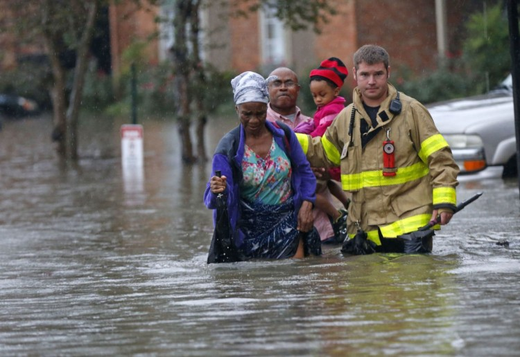 A firefighter helped evacuate a family in Baton Rouge, Louisiana yesterday after 20 inches of rain and flash floods. Two people have been killed so far and the entire state is under an emergency order. The widow of my first mentor posted a photo on Facebook Saturday that showed water running over her porch and into her house. Please pray for the people. (Gerald Herbert/Associated Press)