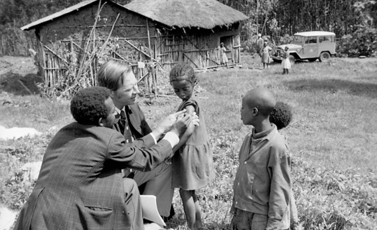 D.A. Henderson has died, an American epidemiologist (later with the World Heatlh Organisation) whose team eradicated smallpox in the 1970s, one of the greatest achievements in the history of medicine. Above: in Ethiopia about 1972, checking on children in a village he immunized. He knew they were winning the battle when, as new cases diminished, he had to start paying people who discovered new infections; then a day came in 1977 when people stopped claiming the prize. He later advised several U.S. presidents on bioterrorism. (WHO)