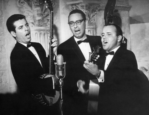 "American folksinger Glenn Yarbrough (right) has died, famous for his years in the 1950s and '60s with the Limeliters and for his solo career (""Baby, the Rain Must Fall""). The son of two social workers, he was constant in his love for the poor and in his quest to live a meaningful life; at the height of his career he sold all his goods, started a school for poor kids and set off to sail the world for years on end. He'd return to land every so often, but only to earn enough money to go back to sea. He got his start in childhood as a chorister at Grace Church, New York. (Everett Collection)"