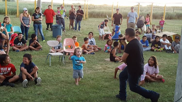Smiles all around as a little girl on the Rosebud Reservation in South Dakota got into the music last week at the Rosebud Youth Concert, co-sponsored by KOYA Radio and the Rosebud Episcopal Mission. The Rosebud Mission has been one of our missionary support projects for the past two years; 10% of our annual budget goes to mision work. (KOYA)