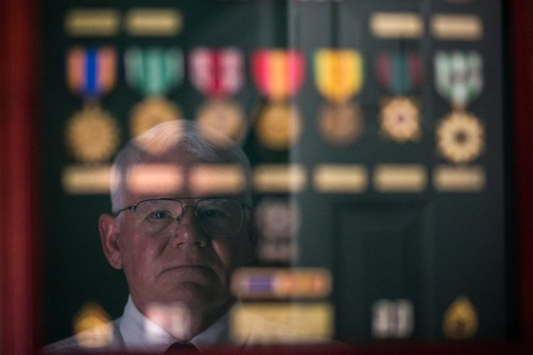 """The United States has finally decided to award retired Sgt. Gary Rose, a medic, the Medal of Honor for heroic service during the """"secret"""" war in Laos 40 years ago, the first time the USA has even acknowledged that such a war took place. Laos was officially off-limits, but the Viet Cong used the border jungles to supply the Ho Chi Minh Trail, and Americans went in after them. Helicopters carried him and 135 Special Forces in, but they took fire before they even landed and casualties were high. For four nonstop days, Rose – the only medic – seemed to do more than humanly possible to save American lives while fighting off the enemy with his own weapon. He is the first veteran of Laos to win the nation's highest honor; there are more veterans waiting for their due. Rose, now retired, spends his time working with the poor and disabled; when a reporter visited, Rose gave him a tour of his church, where he was more excited about the upcoming kids' fundraiser than he was talking about what he did in the war. The Lord was with him those four days. (Joe Buglewicz/The New York Times)"""
