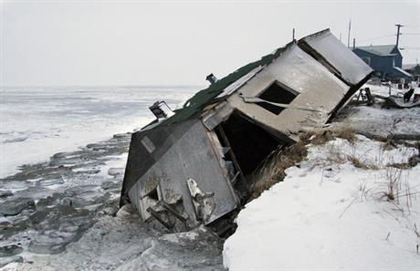 The tiny village of Shishmaref, Alaska is falling into the Bering Strait; this is a file photo from 2005 – they left the ruins where they fell – and the water keeps rising. Recently the 500 residents held a town vote and decided to move inland. But they voted the same way a few years back and nothing happened, because they say it will take $100 million to move. They want to stay together as a town and get new facilities like a school and park, and they seem to expect the government to pay for it – that is, everyone else. It raises questions that seem inevitable with climate change; who pays? Who decides? How many people are affected? What rights do they have? Who gets top priority? For Tuvalu and others, these are critical now. (Diana Haecker/Associated Press)