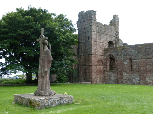 Ruins of the Priory at Lindisfarne, where Aidan and Cuthbert were both monk-bishops. In the foreground is a newer statue of St. Aidan. (Kim Traynor)