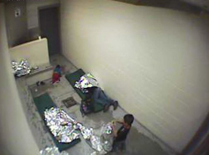 Refugee women and children held in detention in Tucson, Arizona. Kids shouldn't have to live this way; here we've got one crawling around on the concrete floor. (American Immigration Council)