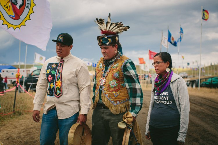 Thousands of people, including representatives of nearly 300 American Indian nations, have converged on the Standing Rock Reservation of the Lakota Sioux, who are protesting construction of an oil pipeline that would skirt their property, disturb the ancient burial grounds of their ancestors, and threaten the water supply of the Missouri River in North Dakota. Today we show you some of people and nations who have joined the fight to protect the water. Here we see Aaron Makwa Chivis, Joe Amik Syrett and Cece Stevens, members of the Anishinaabek people of Michigan. The protest has become a display of Native American unity unmatched in over a century. (All photos: Alyssa Schukar/The New York Times)