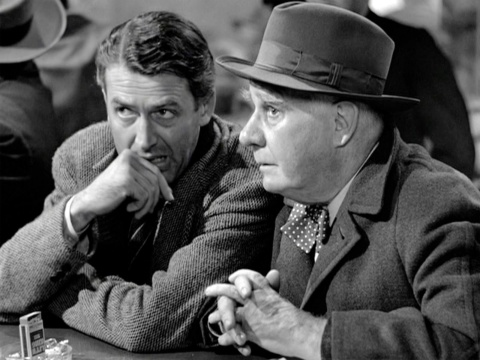 "Angel 2nd Class Clarence Odbody (Henry Travers) saving George Bailey (Jimmy Stewart) from suicide and bankruptcy in ""It's a Wonderful Life."" Did you just hear a bell ring? (Frank Capra)"
