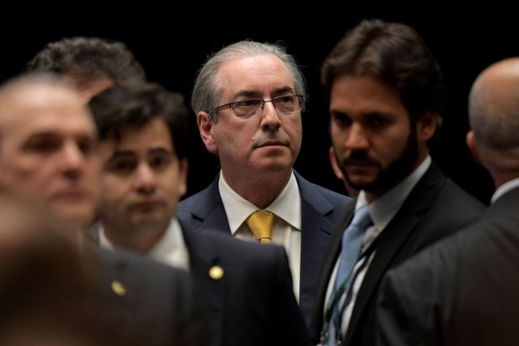 "A few days ago we decried the alleged corruption of the elected leaders of South Sudan, who are killing and terrorizing the population in a civil war over oil money; now comes word about this character, one Eduardo Cunha, the former speaker of the Brazilian House of Representatives. He's not only a politician, but a big radio preacher, and now he stands accused of laundering $40 million through his megachurch to a Swiss bank account. It was St. John Chrysostom who said, ""The road to hell is lined with the skulls of priests,"" but only because he hadn't met any fundamentalist celebrities yet."