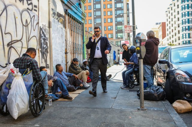 Homeless on San Francisco's Golden Gate Avenue, surrounded by high-tech millionaires, hipsters and hopefuls. The cost of living is so high only the rich can afford to live there - but they're not the only ones who do. (Gabrielle Lurie/The New York Times)
