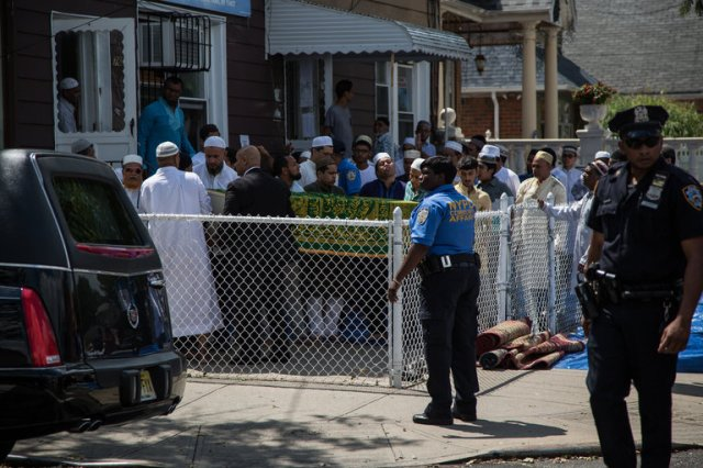Muslims in Queens, New York gathered to await the coffin of their imam and his assistant, who were gunned down on the street in broad daylight last month. (The New York Times)