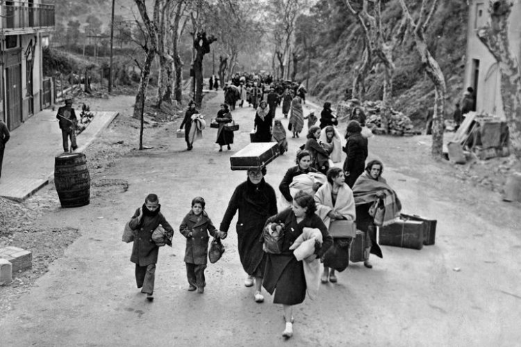 This week we are reading the Book of Esther, in which a royal official in Persia plans the genocide of the Jews; which calls to mind a more recent scene of Jews fleeing the Nazis in Paris, 1940. Never forget; never agaiin. (FPG/Hulton Archives)