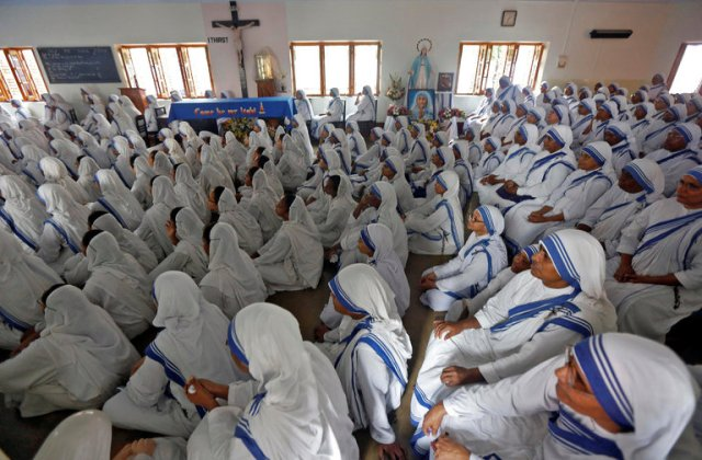Members of Mother Teresa's Missionaries of Charity watched the livestream of her canonization ceremony Sunday in Kolkata. Her order has grown to several congregations, including one for priests and one for male religious. (Ripak De Chowdhuri/Reuters)
