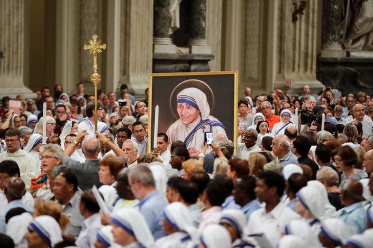 A crowd of 100,000  gathered at the Vatican this weekend for the canonization of Mother Teresa of Calcutta, an exemplar of compassion for the very poor and those shunned because of disease. Above: a procession in her honor on Friday. (Gregorio Borgia/Associated Press)