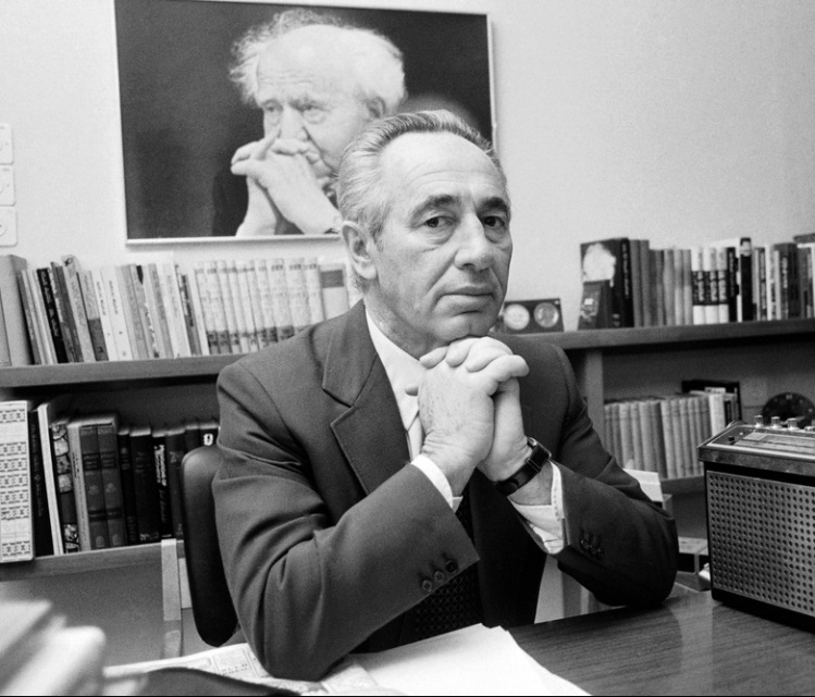 Israel buried former Prime Minister and President Shimon Peres yesterday with dozens of world leaders, including President Obama, in attendance. Peres was one of the founders of the nation in 1948; his mentor David Ben-Gurion is seen in a photo behind him. Peres held a succession of high government posts, including defense minister, and was largely responsible for building Israel's homegrown weapons industry and developing its nuclear weapons. But he was also constant in his search for a peaceful accomodation with Israel's Arab neighbours, and as foreign minister he secured a plan in 1993 for Palestinian self-government in part of the West Bank and Gaza, known as the Oslo Accords for the assistance provided by the government of Norway. When the agreement was signed at the White House with Palestinian leader Yasser Arafat, Peres signed for Israel while his old rival Yitzhak Rabin, then the prime minister, got the big handshake photo op with Arafat. The next year all three of them won the Nobel Peace Prize. (Associated Press, 1984)