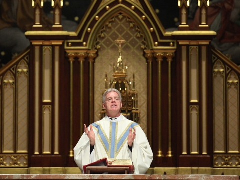 "The Roman Catholic Archbishop of Newark, New Jersey has suspended Fr. Warren Hall because he supports LGBT advocacy groups within the Church, and a Lesbian high school counselor who was fired for marrying a woman in a civil ceremony. Fr. Hall was previously the student chaplain at Seton Hall University, but Archbishop John Myers sacked him because he posted support for a ""No H8"" campaign on Facebook. He was allowed to return to parish ministry until this latest episode, which the the bishop claimed ""confuses the faithful."" Fr. Hall can no longer present himself as a priest or celebrate Mass in public, but he'll be speaking at a PFLAG meeting for LGBTs' parents and friends next week. (Frances Micklow/The Star-Ledger)"