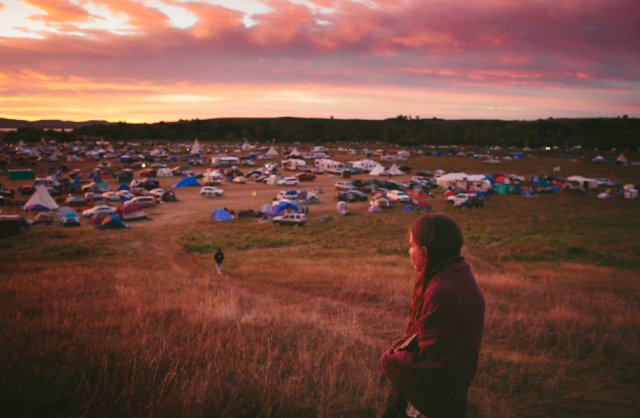 Susan Leopold, of the Patawomeck Nation of Virginia, looked over Sacred Stone Camp where the protesters have gathered. Every tribe is different historically and culturally, but they all share a deep reverence for the land of their ancestors that white people can't understand, unless they've been there and lived with them, following the ancient ways.