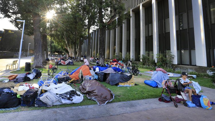 We are frequent advocates for the homeless here, but we also recognize that all the residents of a city have a right to enjoy their public space – which they can't do right now in Santa Ana, California, where a crowd of people who live outdoors have taken over the civic center plaza. The city council is trying to figure out how to evict them while recognizing their civil rights, dignity and need for help. The United States has a shortage of affordable housing, especially in cities, which won't be solved by piecemeal, localized efforts. Economic policy and political wrangling create or diminish homelessness, and local people are caught in the middle. (Allen J. Schaben/Los Angeles Times)