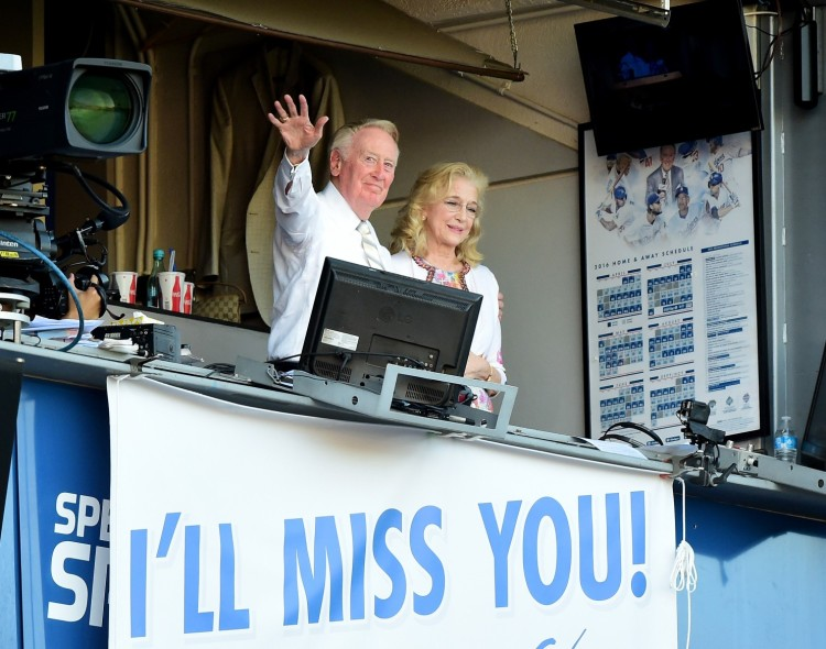 Vin Scully retired last week at the end of Major League Baseball's regular season, after 67 years as the witty, eloquent voice of the Los Angeles Dodgers. At his final game Friday night, the Dodgers trailed by a run with two outs in the bottom of the 9th inning; one more out and his career would be done. But it didn't turn out that way; someone hit a home run to tie the score, and in the next inning the Dodgers pushed across another run to earn their spot in the National League Playoffs. Above, saying goodbye with his wife Sandy, having worked better than anyone else in sports broadcasting and longer than most fans have been alive. (Harry How/Getty Images)