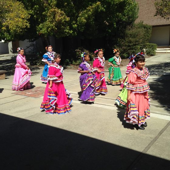 Young Latinas practiced their dancing yesterday at All Saints'/Cristo Rey, Watsonville, California. (Padre Mickey Dresbach)
