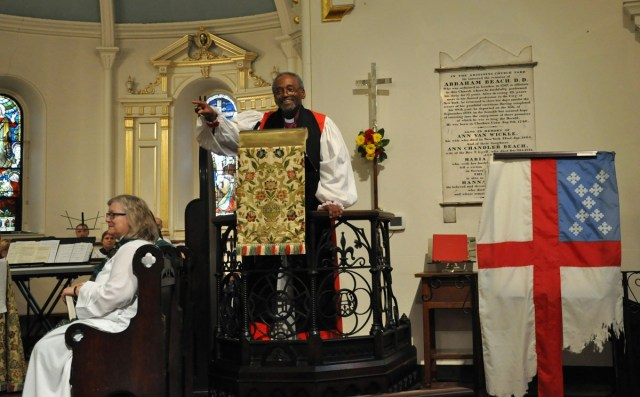 """Episcopal Presiding Bishop Michael Curry preached Friday at historic Christ Church in New Brunswick, New Jersey, where members of the national Executive Council were meeting. Council passed a motion """"standing with Standing Rock,"""" the site of continuing protests of a proposed oil pipeline to be built right next to the Standing Rock Indian Reservation in South Dakota, where The Episcopal Church has many members and a longstanding mission. Curry visited Standing Rock himself a few weeks ago and supported the proposal that law enforcement """"de-escalate military and police provocation in and near the campsites of peaceful protest and witness of the Dakota Access Pipeline project."""" White neighbors say they're inconvenienced by the protest and fear violence – but most of the confrontation has come from police and security guards, who have made many arrests, including visiting journalists. De-escalation is certainly needed, especially since President Obama ordered an end to the construction pending a legal review. Native American leaders are hoping to kill the pipeline, slated to cross the great Missouri River right next to their land. (The Rev. Mary Frances Schjonberg/Episcopal News Service)"""