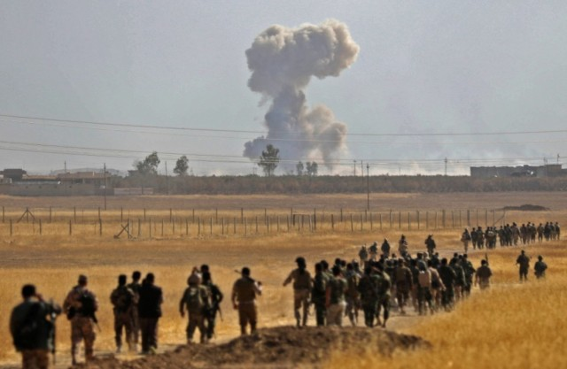 Kurdish peshmergas marching on Narawan, Iraq Thursday, part of the battle for Mosul that's now raging. Let us pray for a swift and just peace. (Safin Hamed/Agence France-Presse)