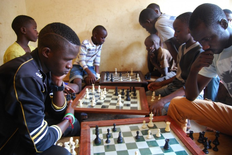 """Queen of Katwe"" is a new Disney movie based on a true story about a girl, Phiona Mutesi, in the Katwe slum of Kampala, Uganda who learns the game of chess at a church-run community center and discovers that she has a world-class talent for it. David Oyelowo and Lupita Nyong'o are winning favorable reviews as the teacher and the girl's mother - but many others in the cast are actual residents of Katwe, where most of the film was shot. The chess program is still running, with even more students engrossed in the game, as photographer Julian Hattem found during a recent visit. As you can see, these kids aren't the least interested in having their pictures in the Washington Post; the game is much more engrossing."