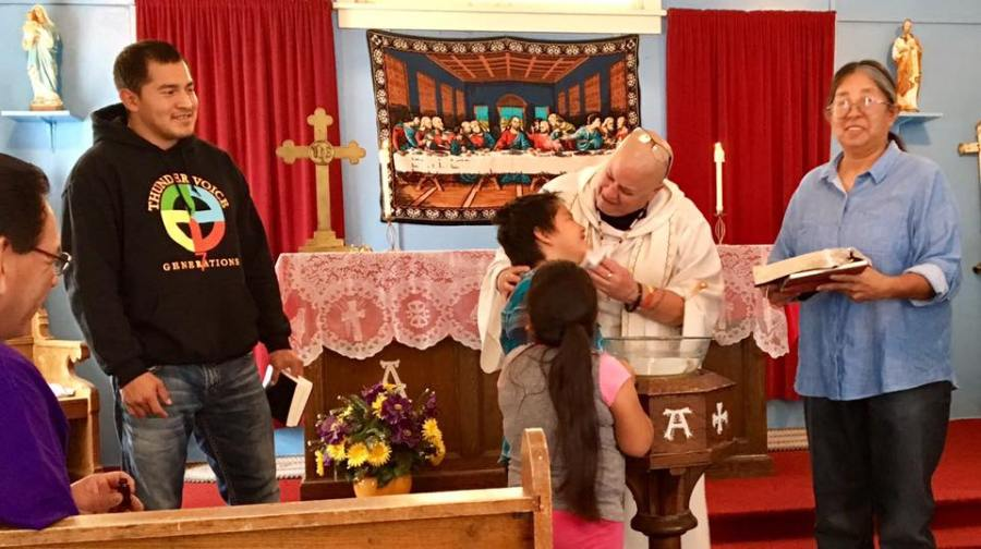 Advent is a time of preparing for Christ's return; and that suggests repentance and baptism. This one, at the Rosebud Episcopal Mission on the Lakota reservation in South Dakota, seems to have been fun, too, like kids usually have with Mother Lauren Stanley. (parish photo)