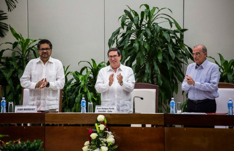 Colombian leaders announced a new peace deal in Havana on Friday, which they hope will answer voters' rejection of the previous one, which sought to end a 52-year-long civil war with FARC rebels. Some voters said the previous agreement was too lenient with the rebels, giving them amnesty and automatic seats in Parliament – but it was also undermined by anti-Gay Roman Catholics and Pentecostals seeking to topple the government. (Desmond Boylan/Associated Press)
