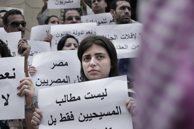 """Coptic Christians in Egypt are increasingly restive under the Sisi government, as longstanding discrimination continues, along with violence and high unemployment. These signs at a recent demonstration say, """"Our demands are not just for Christians but for all Egyptians."""" (Nariman el-Mafti/Associated Press)"""