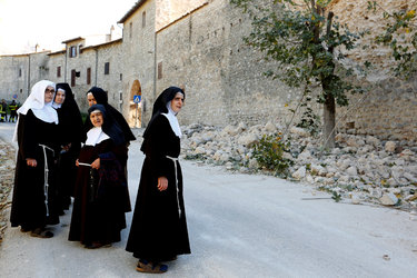 Benedictine nuns in Nursia looked over the damage to their convent a week ago; the Basilica of St. Benedict, built in the 13th century on the piazza in the old city and connected to the saint's male monastery, was destroyed. (Remo Casilli/Reuters)