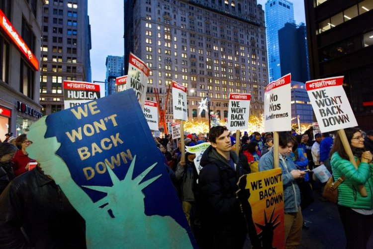 Despite the election of Donald Trump in the U.S., low-wage workers and labour unions are continuing to push for a much higher minimum wage, dubbed the Fight for Fifteen (Dollars). McDonald's employees took to the streets in New York City, while in Detroit and Chicago, workers walked off the job in the busiest airports. The four-year-old movement has won bigger paychecks in California, New York and scores of cities. Many of those protesting voted for Trump, who says the national minimum wage ($7.25) should be abolished. (Mark Lennihan/Associated Press)