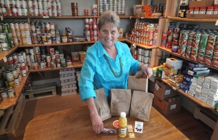 "Here's a ""work"" a lot of Episcopalians enjoy: Nancy Johnson coordinates the food pantry at Grace Church, Traverse City, Michigan. (parish photo)"
