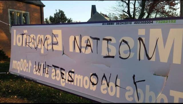 """If you were with us this morning you know about the vandalizing of Episcopal churches in the wake of the election of Donald Trump; we published a photo of Nazi slogans, symbols and """"fag church"""" painted on the side of St. David's, Bean Blossom, Indiana, and above we see the back of a sign welcoming Latinos at Church of Our Saviour, Hillandale in Silver Spring, Maryland, a suburb of Washington, D.C. The exterior wall of their columbarium was also desecrated. Pray that the criminals repent and the congregations and communities keep calm and carry on. (Diocese of Washington)"""