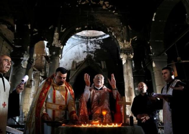 You've heard of the battle for Mosul, now raging in Iraq; here was the scene a week ago, 30 October, when Christians were able to get back into their Church of the Immaculate Conception in nearby Qaraqosh, now liberated. The magnificent church has suffered heavy damage, but the clergy and people were able to celebrate the Eucharist among the ruins. What a blessing that must have been. (Ahmed Jadallah/Reuters)