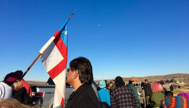 Carrying the Episcopal Church flag during the Clergy for Standing Rock procession Thursday at the Lakota Sioux reservation in North Dakota, which is fighting to prevent construction of an oil pipleine that could ruin their water supply. (The Rev. Lauren R. Stanley)