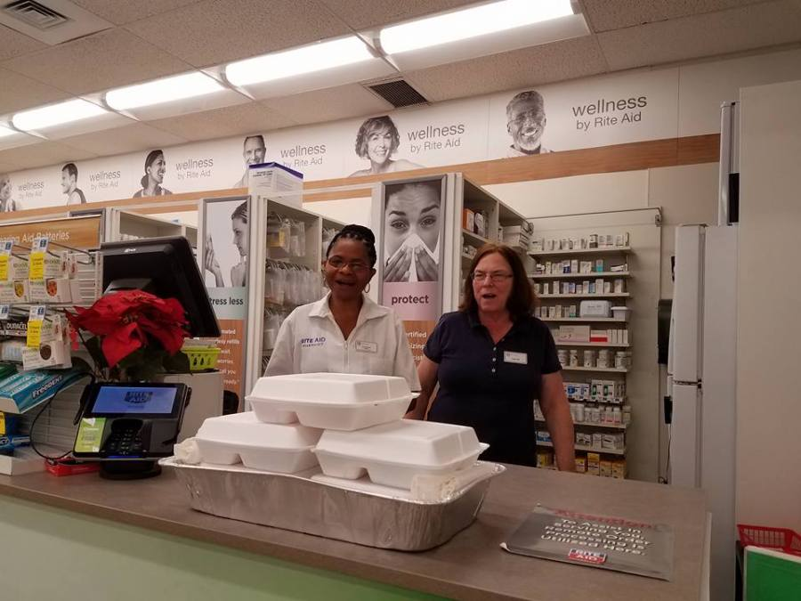 """As we've reported, there were many free Thanksgiving dinners held this week in the United States by churches and community groups; in Brunswick, Maryland, volunteers delivered meals to retail employees who had to work on the holiday. """"You brought this for us?"""" (The Rev. Anjel Scarborough)"""