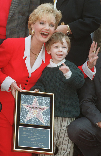 "We were sad to learn of the death of Florence Henderson a few days ago, the quintessential TV mom for people of a certain age; ""The Brady Bunch"" was the first U.S. series to show a blended family. It was all sweetness and light, which helped her win the part; she was a smalltown girl from Dale, Indiana with a strong, true soprano and an upbeat personality. Above, with her grandson several years ago, receiving her star on the Hollywood Walk of Fame. (Chris Pizzello/Associated Press)"