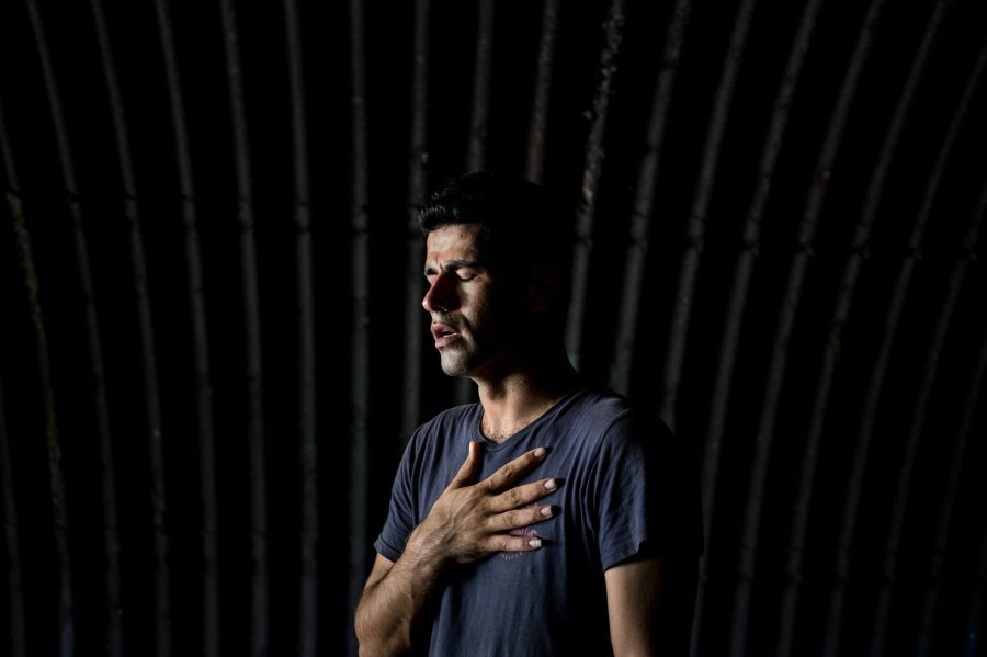 "Karam Zahirian, an Iranian held by Australia on Manus Island, Papua New Guinea, started shaking when a photographer asked to take his portrait and inquired about what he'd been through. He could barely speak, and shrugged at permission to cry if he wanted. He said, ""I have nothing left."" (Ashley Gilbertson/VII)"