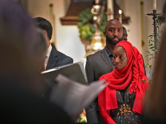 Local Muslims were honoured guests at the main Christmas Eve service Saturday night at Christ Church Cathedral, Indianapolis. Muslims revere Jesus too, though not as their Savior, and the visitors were warmly welcomed. (Kelly Wilkinson/The Indianapolis Star)