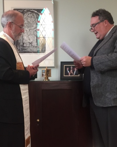Matthew McCormick (right), a priest who left The Episcopal Church in 2012 during the schism in the Diocese of South Carolina, has returned, renewed his ordination vows and been reinstated by Bishop Skip Adams, who shepherds what is now called the Episcopal Church in South Carolina. (diocesan photo)