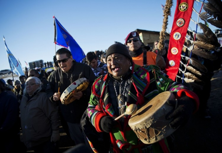 The U.S. Army Corps of Engineers announced yesterday that it will not issue permits to complete the Dakota Access Pipeline adjacent to the Standing Rock Indian Reservation in North Dakota. The decision came less than a day before state and local police and the company's highly sophisticated security personnel were set to try to evict protesters from the sacred site, while hundreds of U.S. military victims pledged to shield the Native people with their bodies. Coming nearly at the end of President Obama's term, this is not a final victory for the indigenous people, whose cause has spread worldwide, but it is a major victory nonetheless, as people celebrated with prayer, song and drumming around a bonfire. (David Goldman/Associated Press)