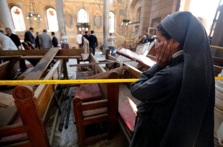 There's been another attack on Christians in Cairo, this time on St. Mark's Coptic Orthodox Cathedral, where 25 pounds of TNT somehow slipped past government security guards and killed at least 25, mostly women and children, and injured another 49 so far. The Coptic Orthodox, led by Pope Tawadros II, are the largest denomination in Egypt and North Africa, and have been independent both of Rome and of Eastern Orthodoxy since the Council of Chalcedon in 451. The church traces its founding to St. Mark the Evangelist. (Amr Abdallah Dalsh/Reuters)