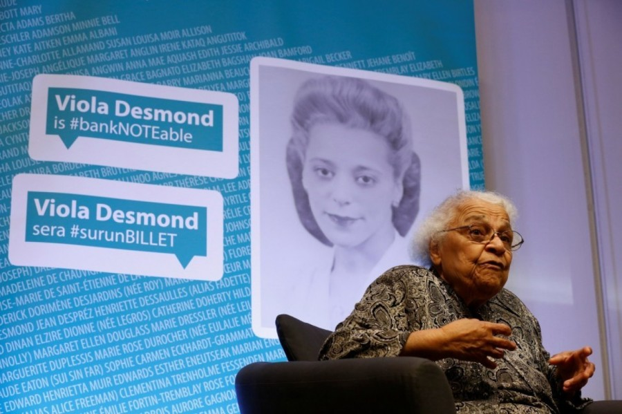 """Viola Desmond, """"the Rosa Parks of Canada,"""" will become the first woman depicted on folding money in that country, in honour of her protest against a segregated movie theater in 1946; her car broke down, so she got it to a mechanic and went to see a movie while she waited. She bought a ticket, sat in her seat and then was told she had to move to the balcony – a different ticket with a higher price of one cent. She wouldn't move, got arrested and was convicted, all on the basis of that penny. Racial segregation was not as severe in Canada as it was in the USA at the time, but they hadn't abolished racism in movie theaters in Nova Scotia, either. Above: her surviving sister Wanda Robson at the big unveiling. (Chris Wattie/Reuters)"""