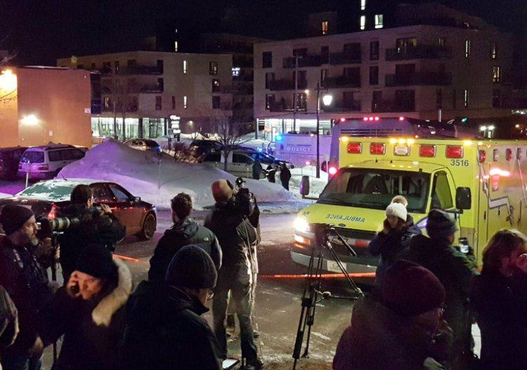 """Six people were reportedly killed by gunmen Sunday night during Evening Prayers at the Islamic Cultural Center of Québec City, Canada. As of midnight, police reported that two gunmen had been arrested. Prime Minister Justin Trudeau called the slaughter """"a terrorist attack on Muslims."""" (Mathieu Belanger/Reuters)"""
