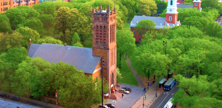 The Village Green in New Haven, Connecticut has three churches side by side: two Congregational (Center and North Churches respectively) and one Episcopal, Trinity on the Green, foreground, the first Gothic Revival building in the United States, built in 1815 by Ithiel Town. Yale was founded in 1701 as a Congregationalist seminary. (via the Rev. Michael Hartney)