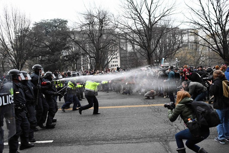Pepper-spraying demonstrators during the U.S. presidential inauguration 10 days ago; we haven't seen this before after somebody won an election. (Jewel Samad/Agence France-Presse)