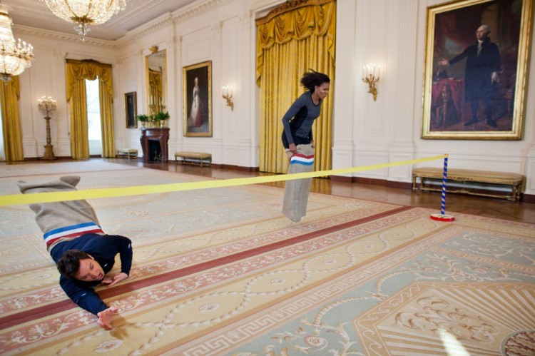 A sack race across the East Room of the White House, with George Washington calling Michelle Obama the winner over comedian and talk show host Jimmy Fallon. No matter what you've heard about the Obamas, she remains the most admired woman in America, not least because of fun stuff like this. (Chuck Kennedy/The White House)