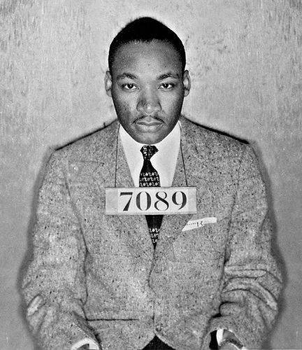 Dr. Martin Luther King Jr. was arrested 30 times in his short life, most notably in Birmingham, where he wrote his famous Letter from a Birmingham Jail; but this is not that booking photo; that day he was wearing blue jeans and a casual shirt. We believe this may be the mug shot taken after his first arrest in 1955 for leading the Montgomery, Alabama bus boycott, a yearlong campaign that launched him to world prominence. Our search for the origin of this photo proved fruitless, except in illustrating how often it has been republished around the world. You're looking at the best of America here; take hope from him.