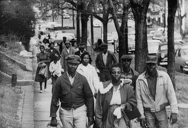 An early shot of the Montgomery, Alabama bus boycott in 1955, the same period when Willie Evans was playing ball at the University of Buffalo. Rosa Parks and the women of Montgomery's black community kicked off the boycott by refusing to sit in the back of city buses – which meant everyone had to walk or catch a ride. This is the campaign that launched Martin Luther King, Jr. as a national civil rights leader. The white businessmen of Montgomery held out for a year, and then they caved like a castle in the sand. But the work was only beginning, as we know. (uncredited news photo)