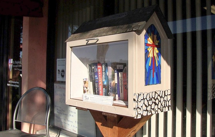 The tiny free library oustide St. Stephen's, Hurst, Texas, a congregation recovering nicely from the anti-Gay schism ten years ago in the Diocese of Fort Worth and the subject of this evening's video; see below. Nice stained glass window! (The Rev. Mary Frances Schjonberg/Episcopal News Service)